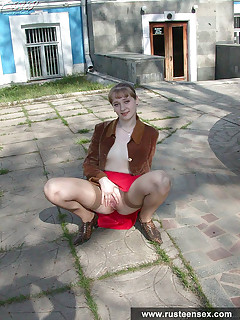 Russian teen blonde Sarah shamelessly posing naked outdoor showing upskirted teen pussy in the streets