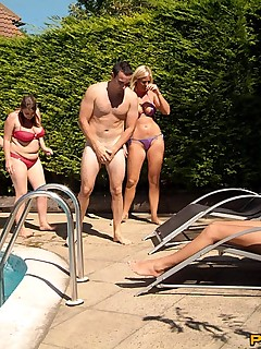 Caught sleeping naked in the pool, four girls help themselves to his cock